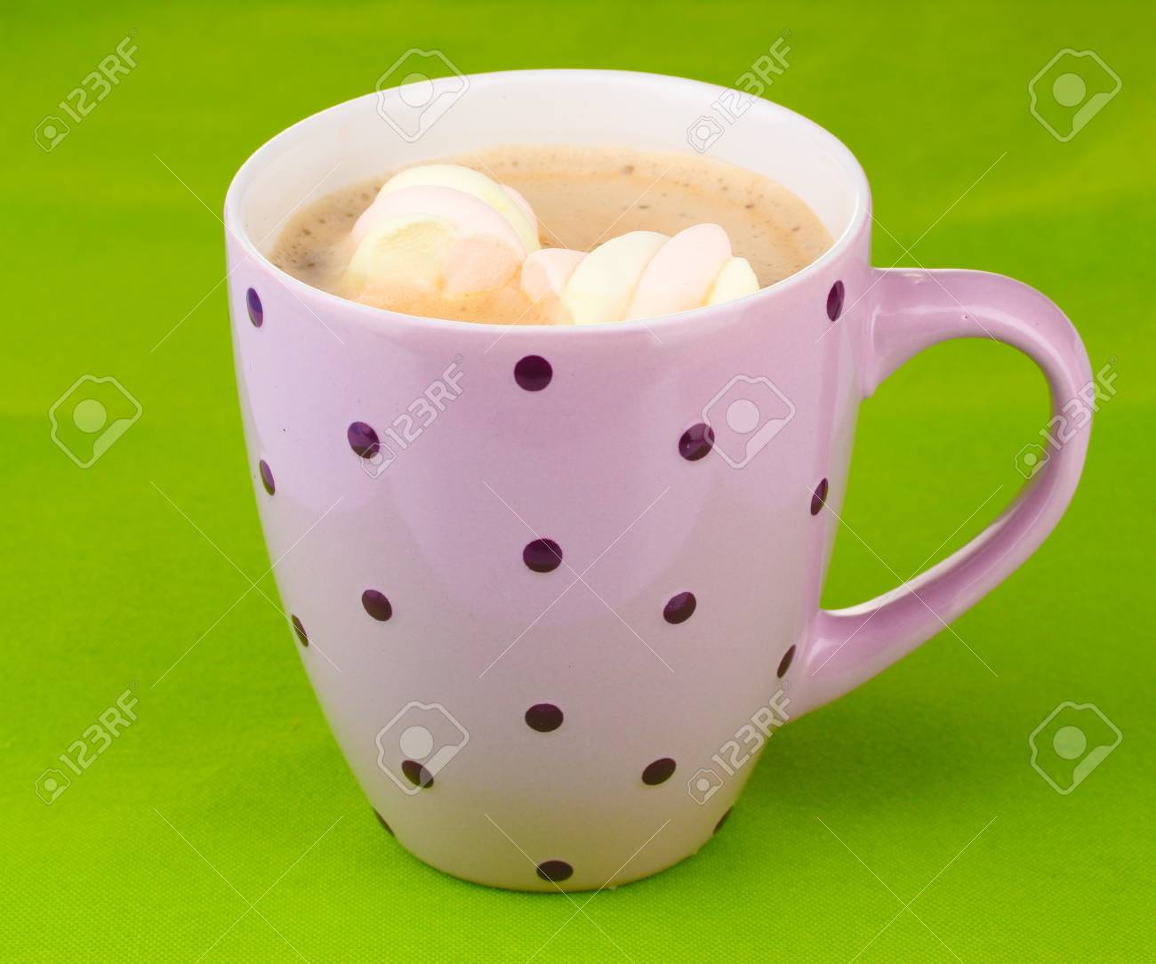 Cup of cappucino with marshmallows on green background Stock Photo - 12113168