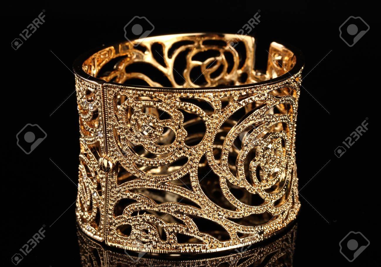 beautiful golden bracelet on black background Stock Photo - 12266117