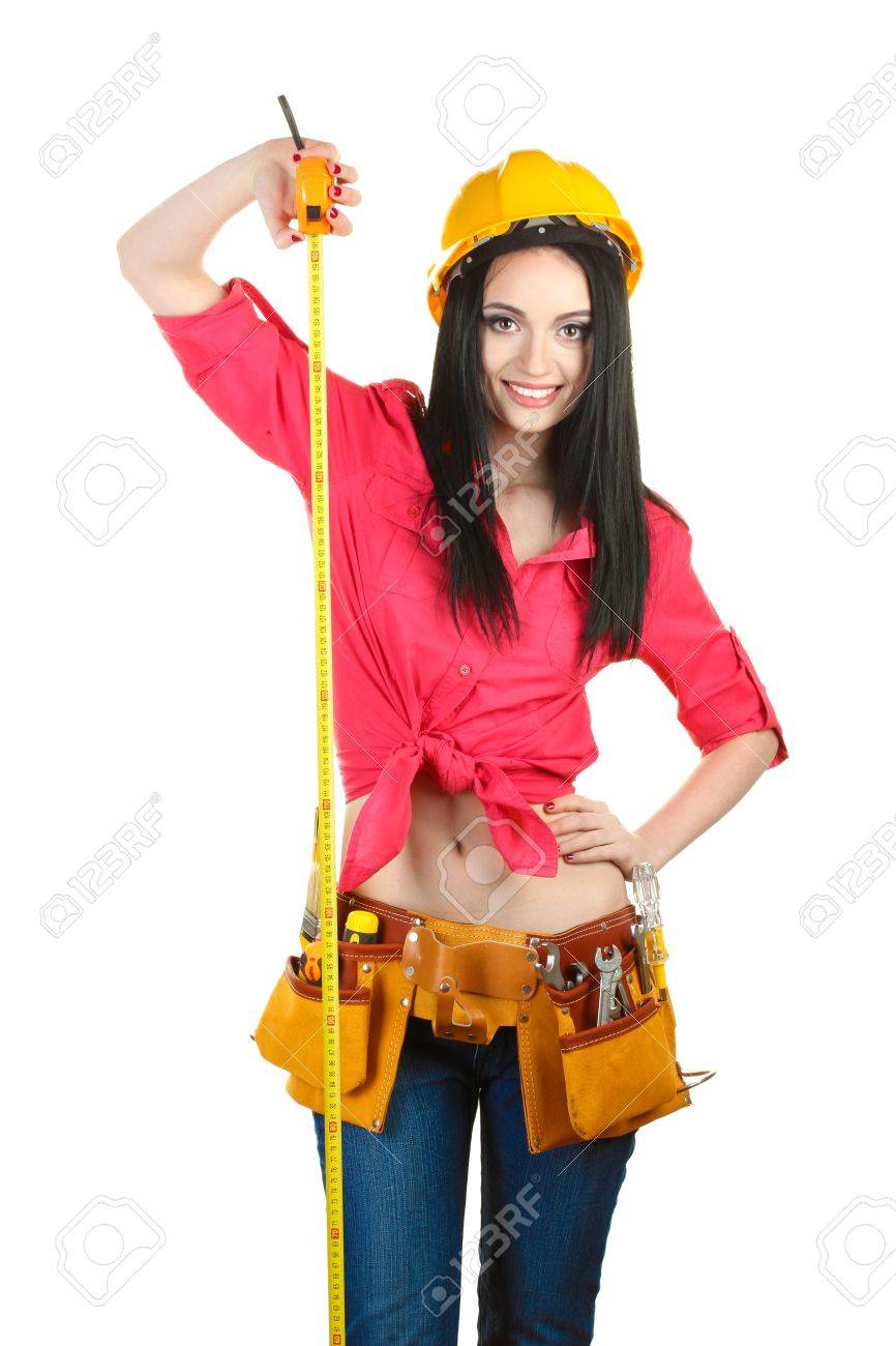 beautiful young girl-builder holding building roulette isolated on white  Stock Photo - 12312766