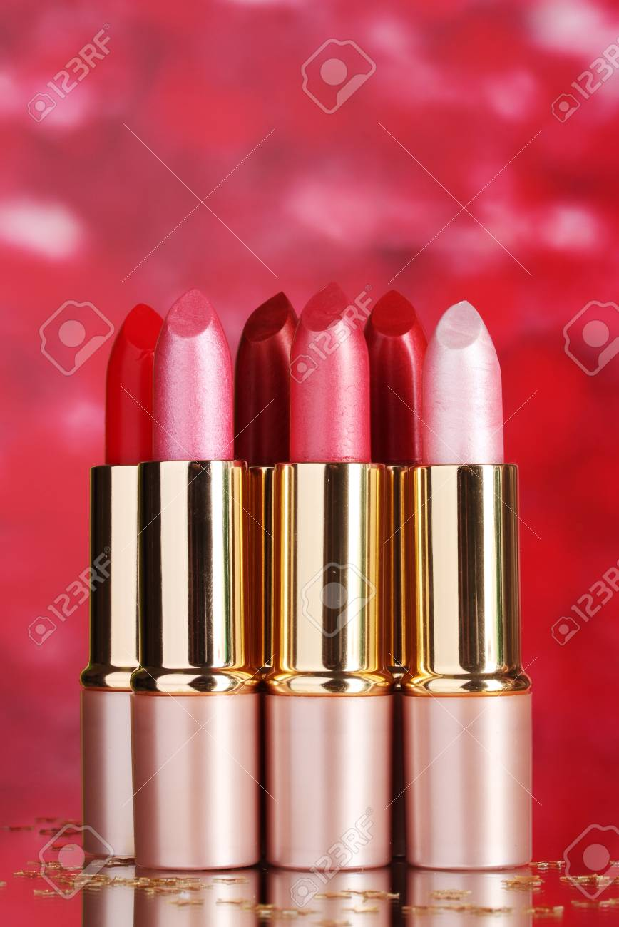 beautiful lipsticks on red background Stock Photo - 12436123