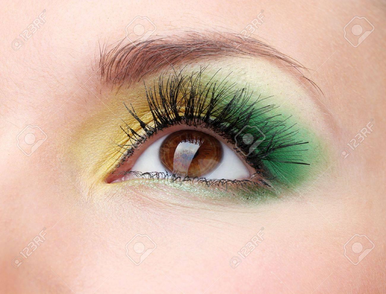 beautiful female eye with bright make-up - 12632552