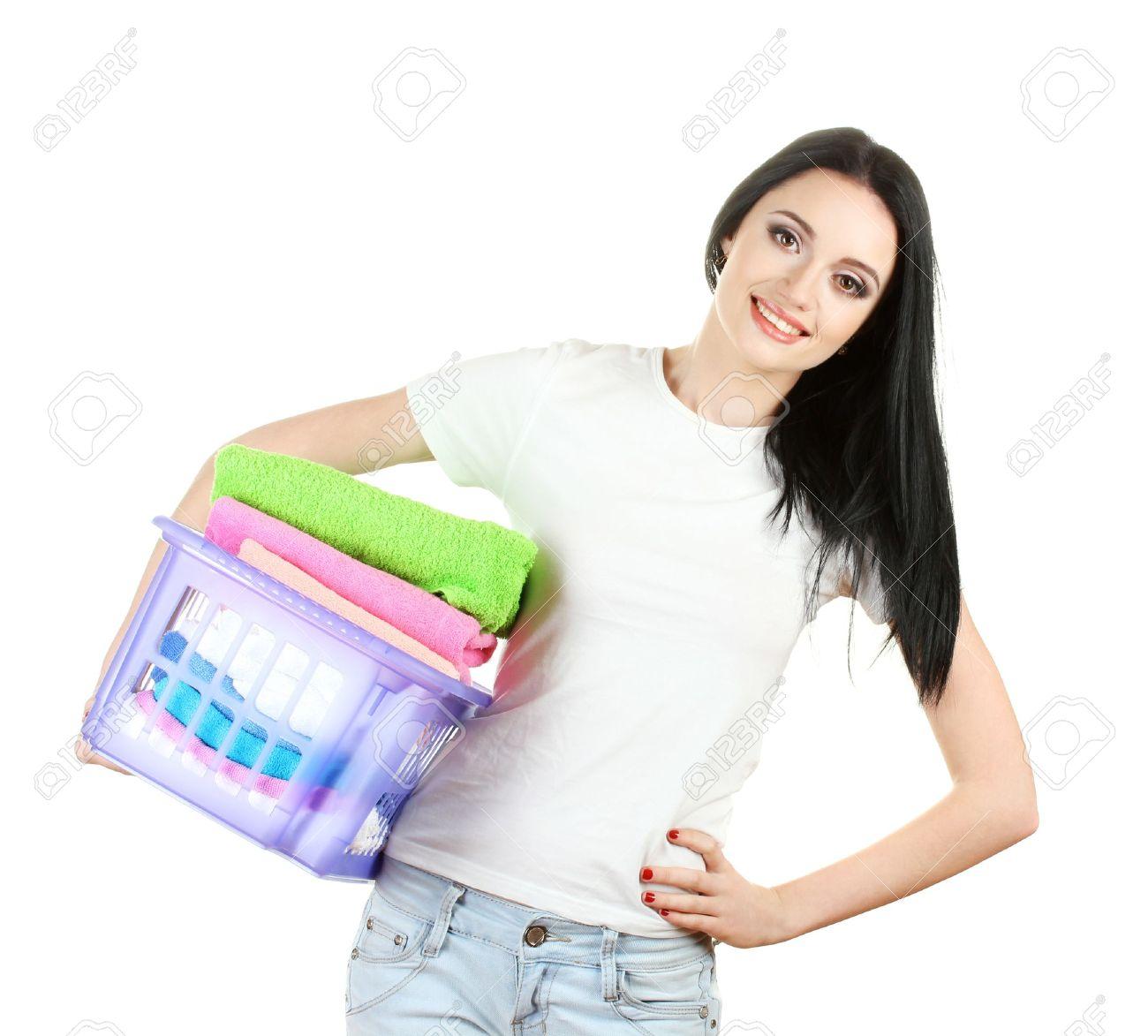 beautiful young girl holding basket of laundry isolated on white Stock Photo - 13050289