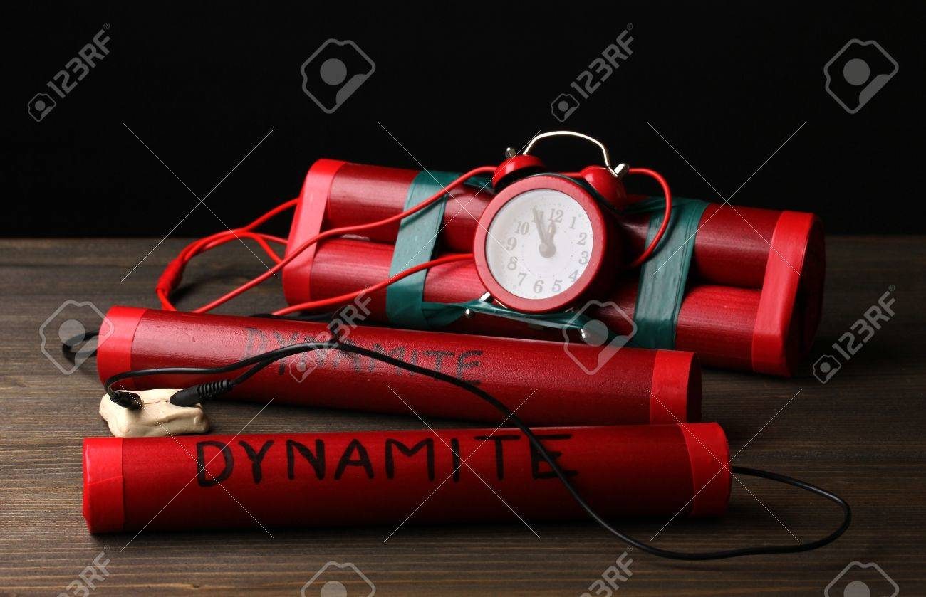 Timebomb made of dynamite on wooden table on black background Stock Photo - 12716292