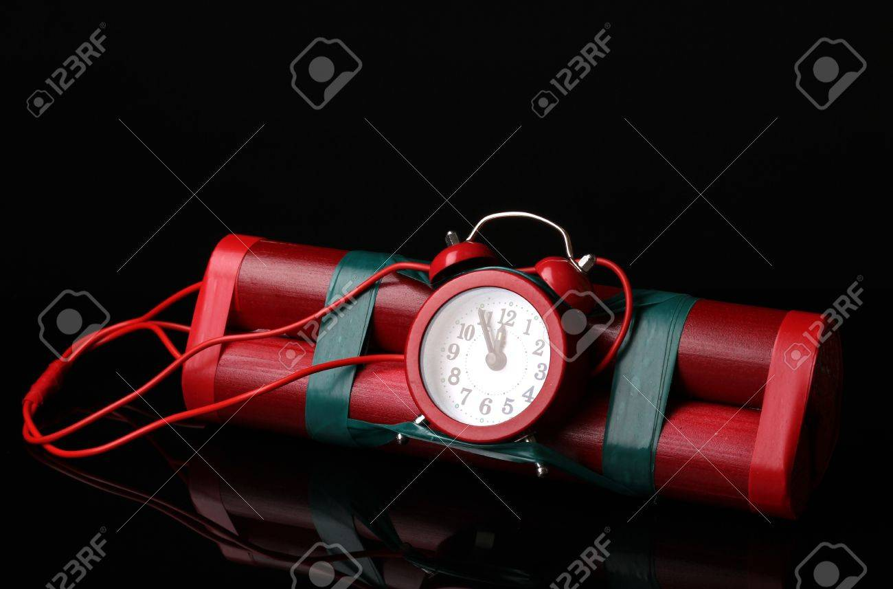 Timebomb made of dynamite isolated on black Stock Photo - 12800609