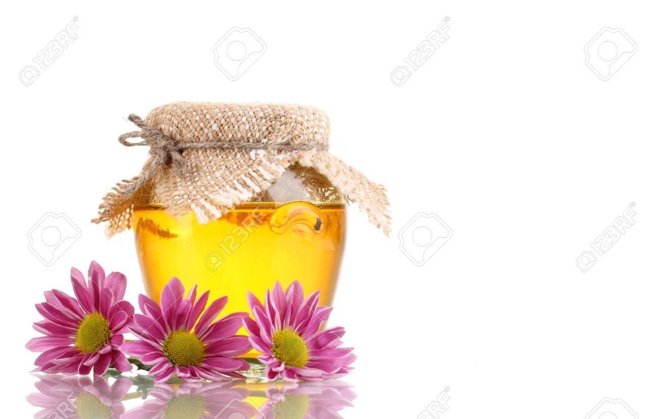 Sweet honey in jar isolated on white Stock Photo - 12892062