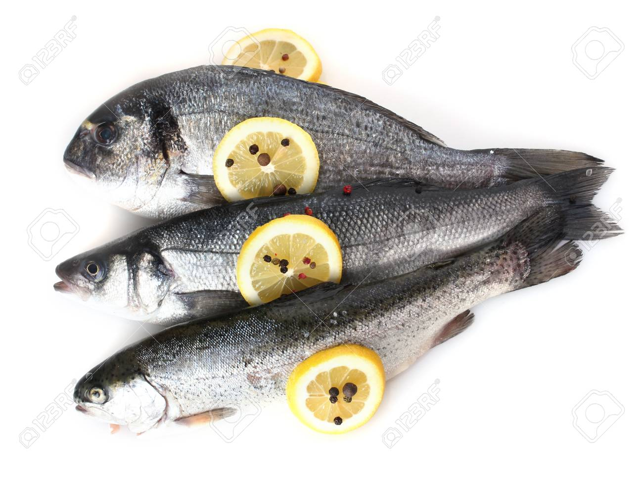 Fresh fishes with lemon and pepper isolated on white Stock Photo - 12892103