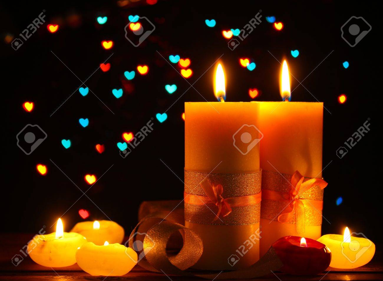 Beautiful candle and decor  on wooden table on bright background Stock Photo - 12891949