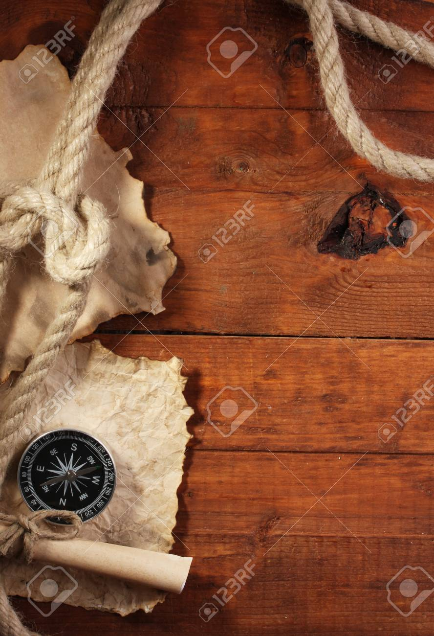 old paper, compass and rope on a wooden table Stock Photo - 12979811