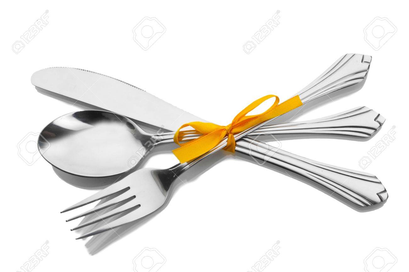 Silver fork and spoon, knife tied with a yellow ribbon isolated on white Stock Photo - 12980358