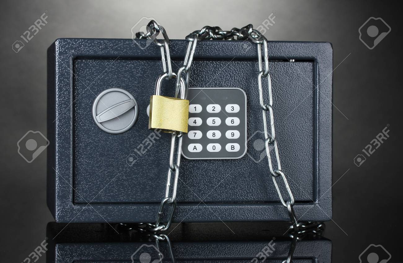safe with chain and lock on grey background Stock Photo - 12979856