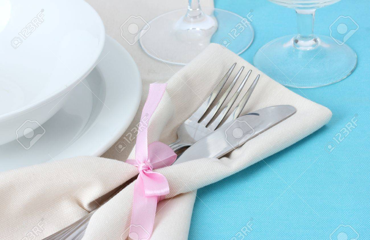 Table setting with fork, knife, plates, and napkin Stock Photo - 12979536