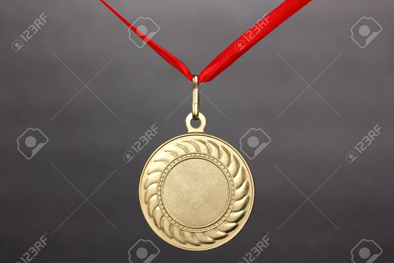 Gold medal on grey background Stock Photo - 13025062