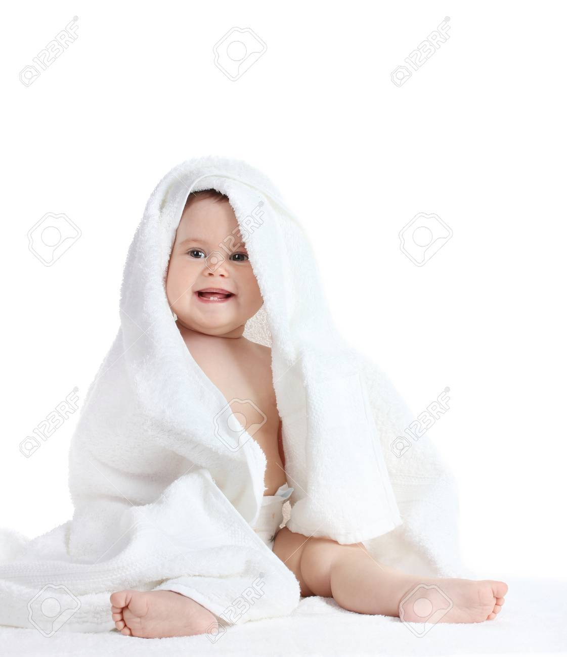 Cute baby girl with towel isolated on white Stock Photo - 13446394