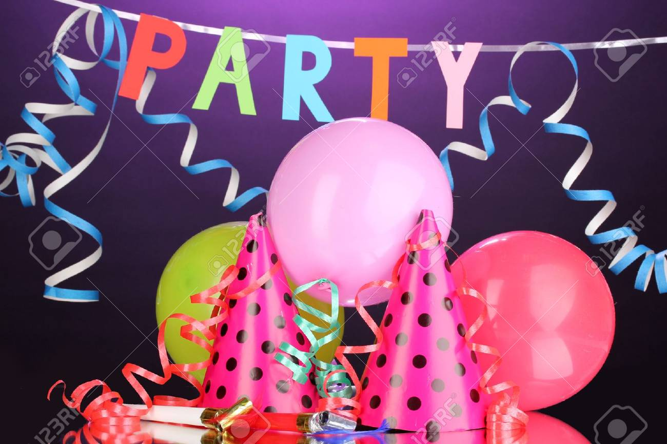 Party items on purple background Stock Photo - 13052962
