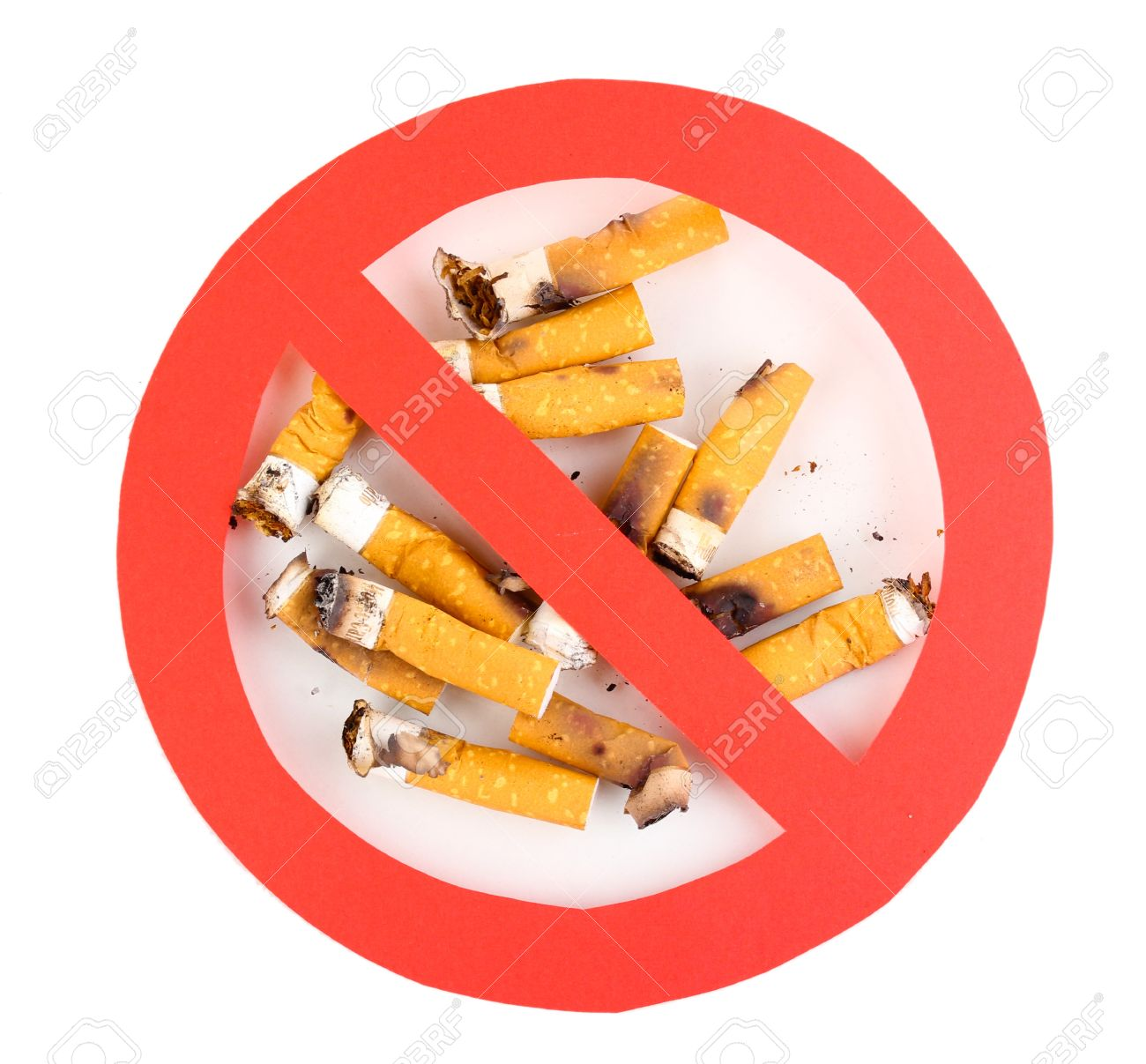 Cigarette butts with prohibition sign isolateed on white Stock Photo - 13061704