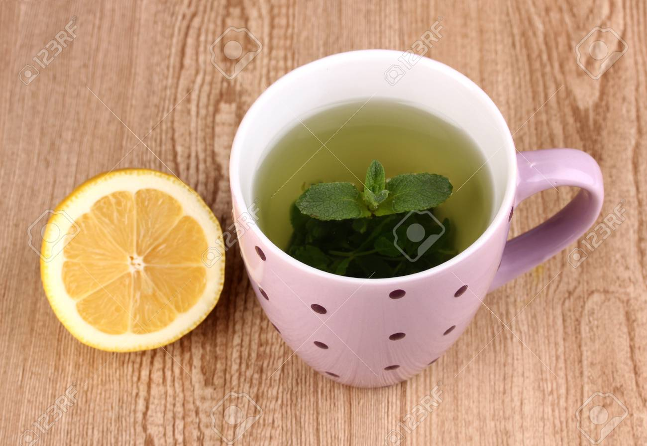 Mint tea with mint leaf and lemon on wooden background Stock Photo - 13100101