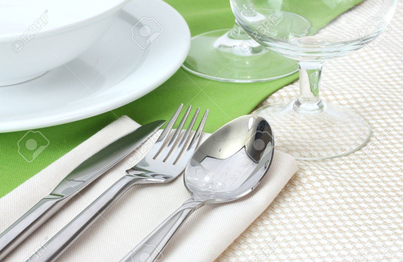 Stock Photo - Table setting with fork knife spoon plates and napkin & Table Setting With Fork Knife Spoon Plates And Napkin Stock ...