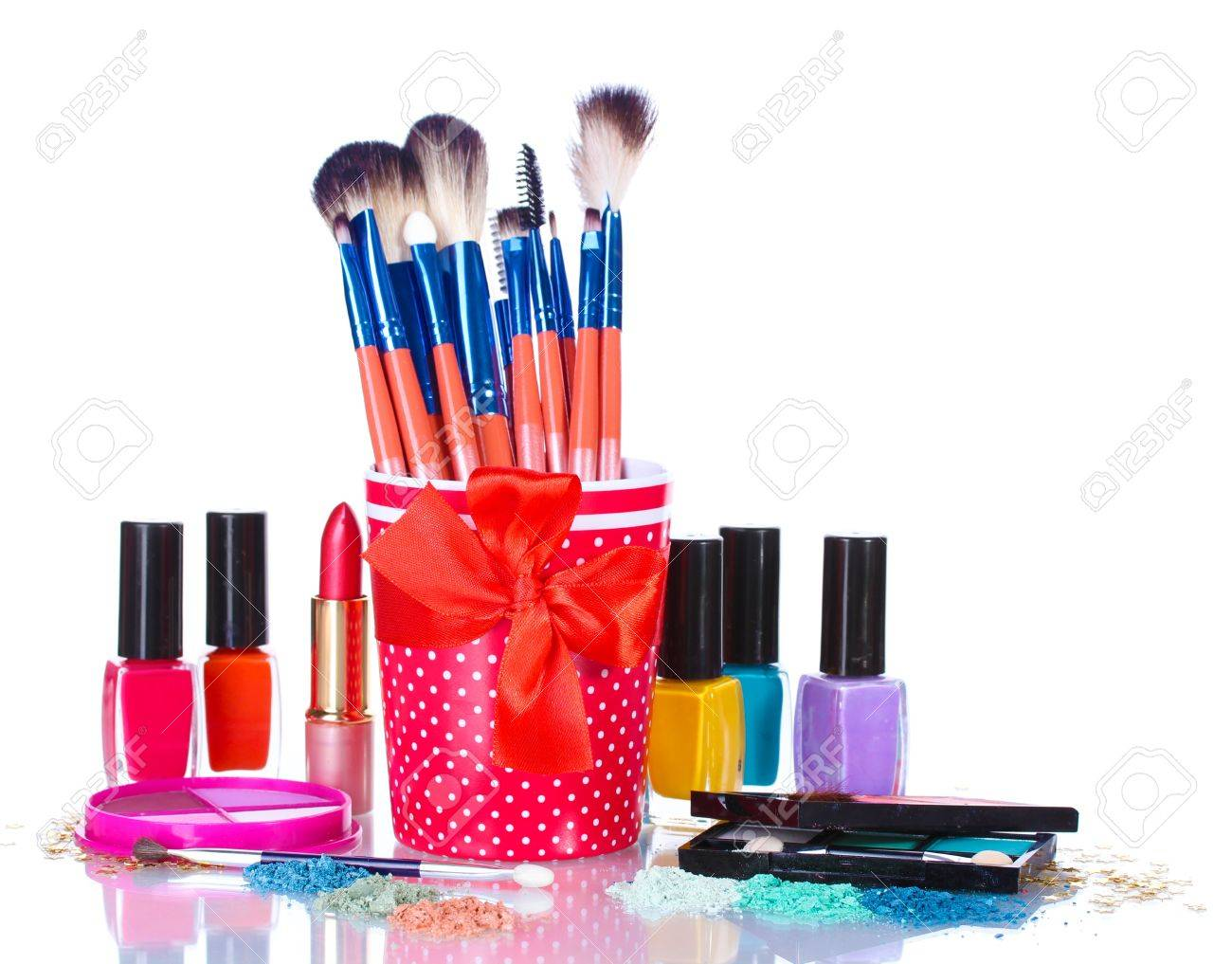 make-up brushes in cup and cosmetics isolated on white Stock Photo - 13213726