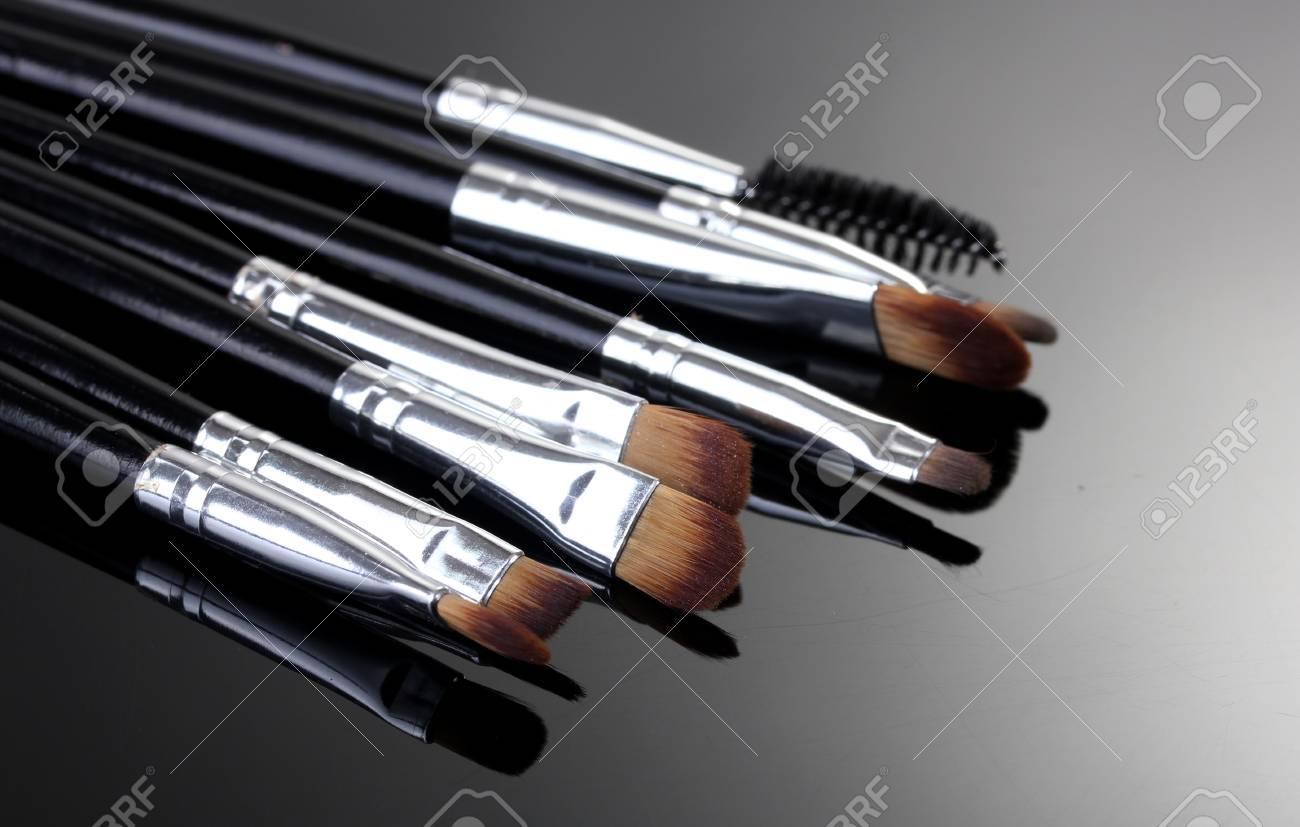 make-up brushes on grey background Stock Photo - 13234273