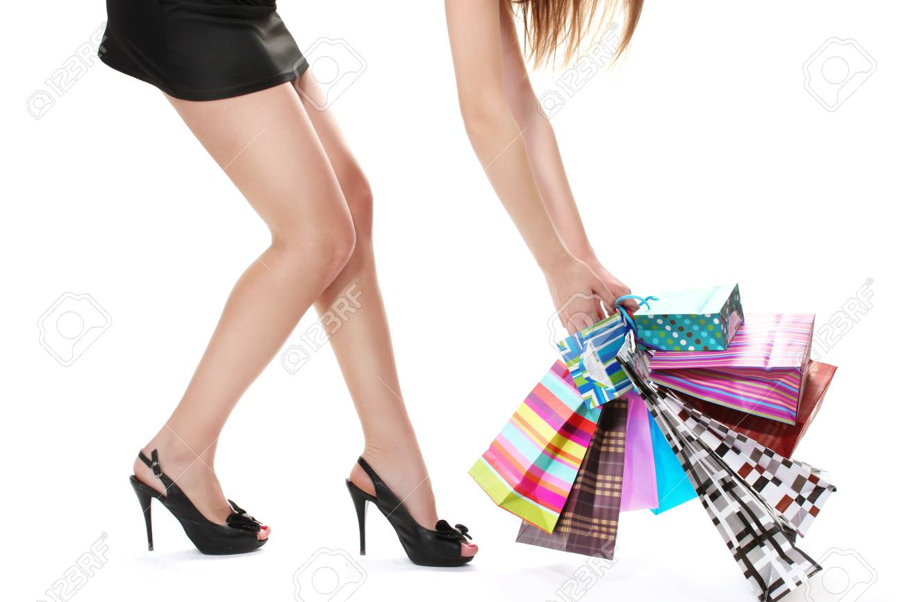 beautifu woman with shopping bags isolated on white Stock Photo - 13355883