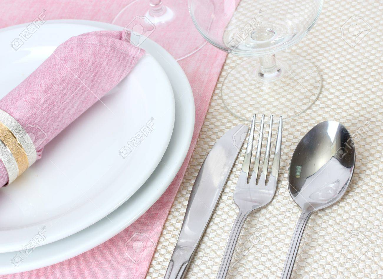 Table setting with fork, spoon, knife, plates, and napkin Stock Photo - 13356211