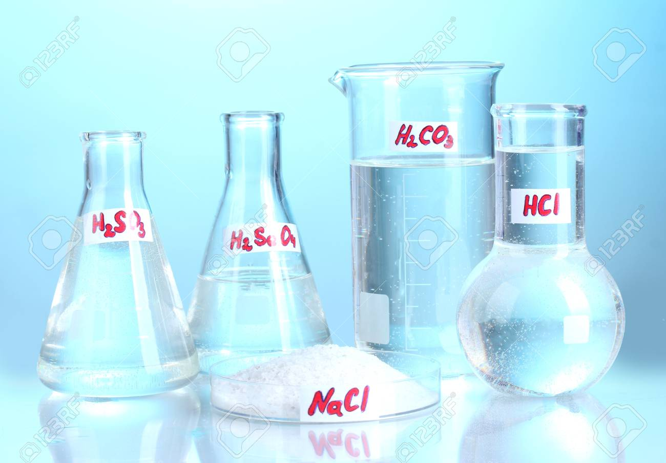 Test-tubes with various acids and chemicals  on blue background Stock Photo - 13356010