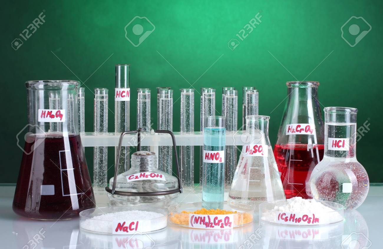 Test-tubes with various acids and chemicals  on bright background Stock Photo - 13356199