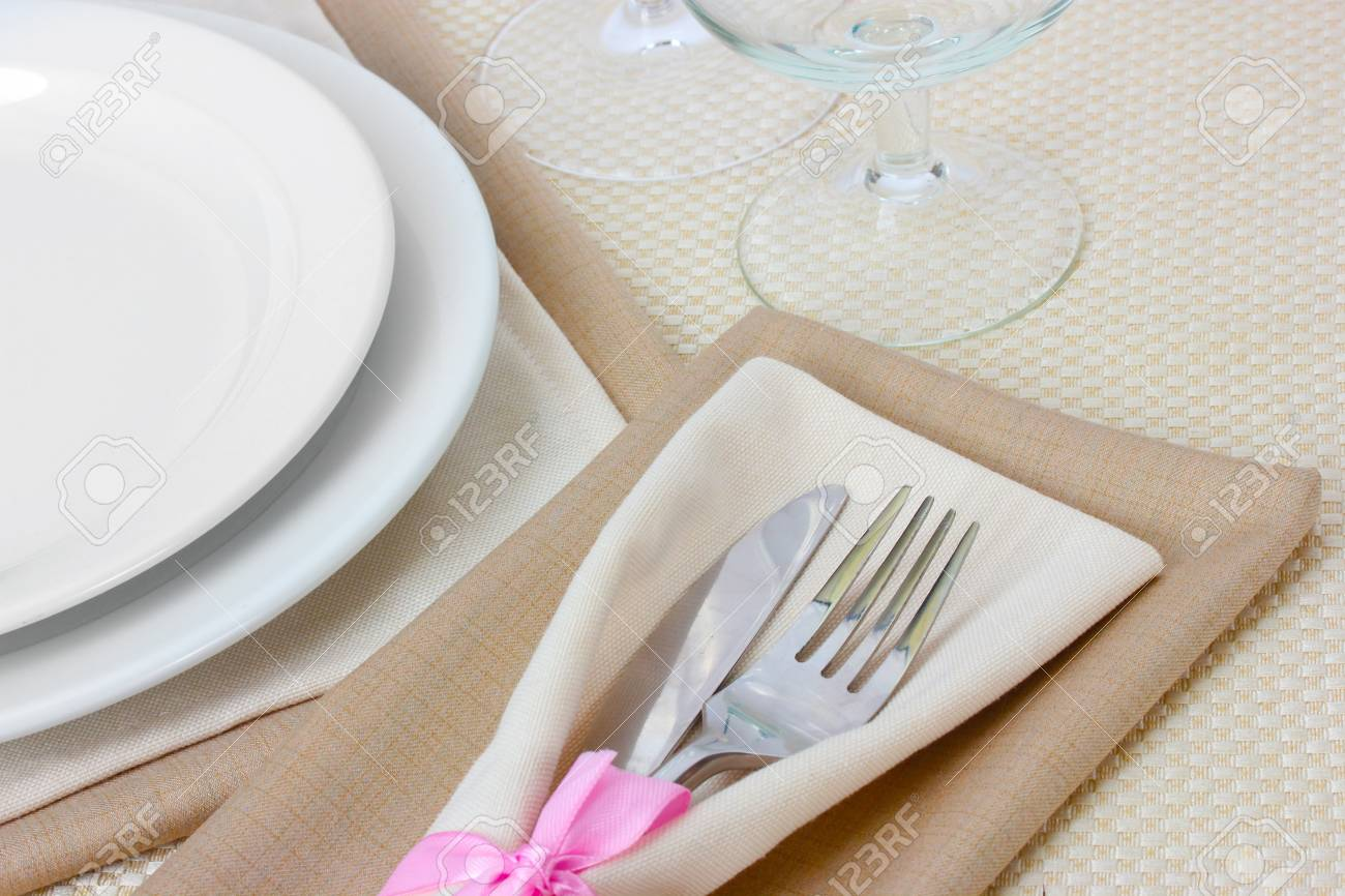 Table setting with fork, knife, plates, and napkin Stock Photo - 13438911