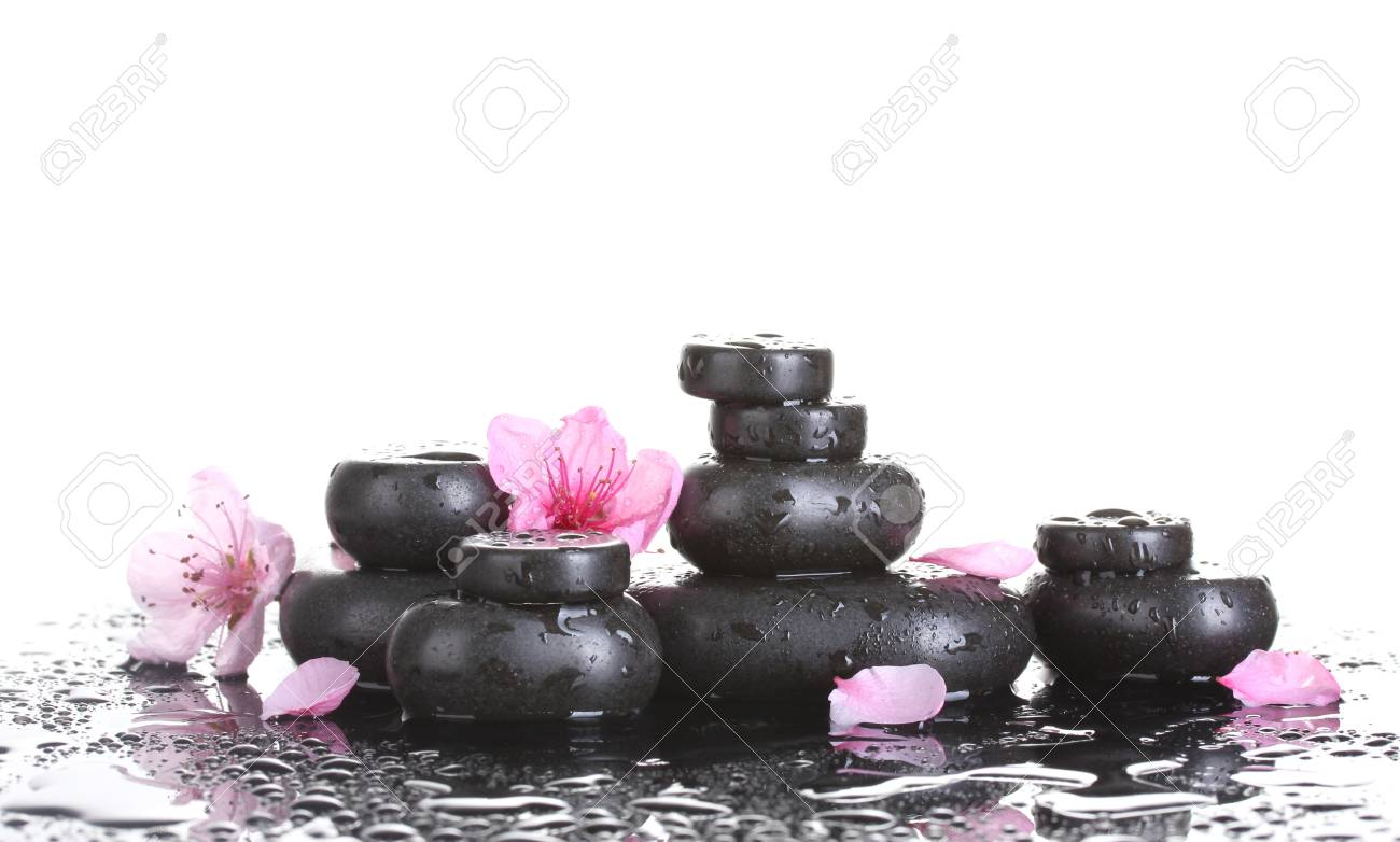 Spa stones with drops and pink sakura flowers on white background Stock Photo - 13438470