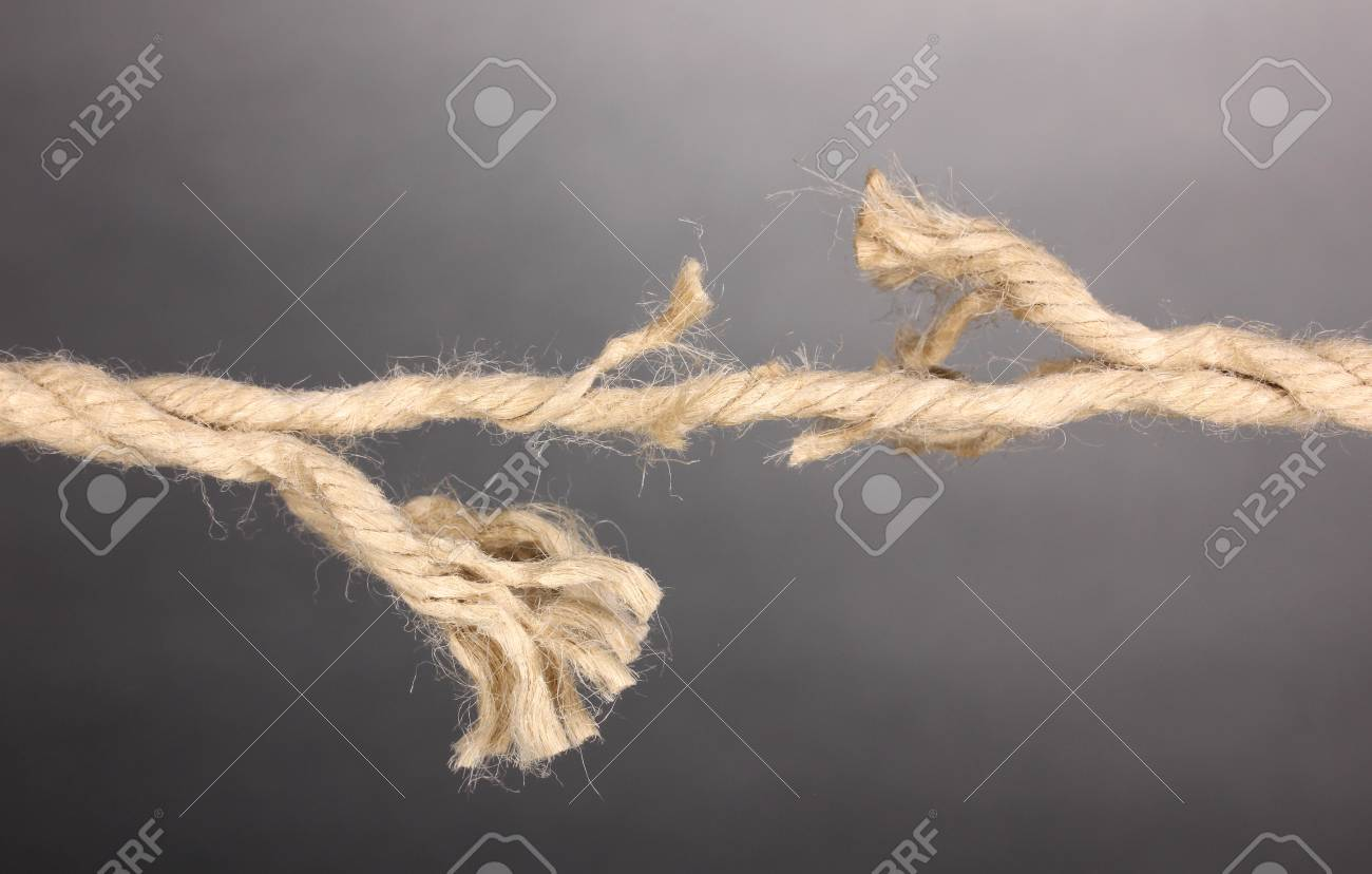 Breaking rope on grey background Stock Photo - 13438886