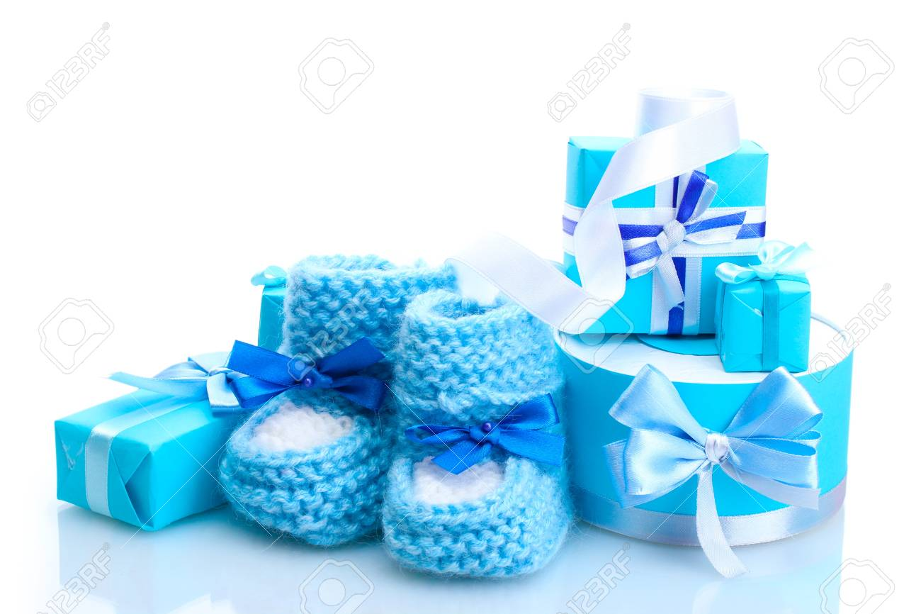 beautiful gifts and baby's bootees isolated on white Stock Photo - 13520942