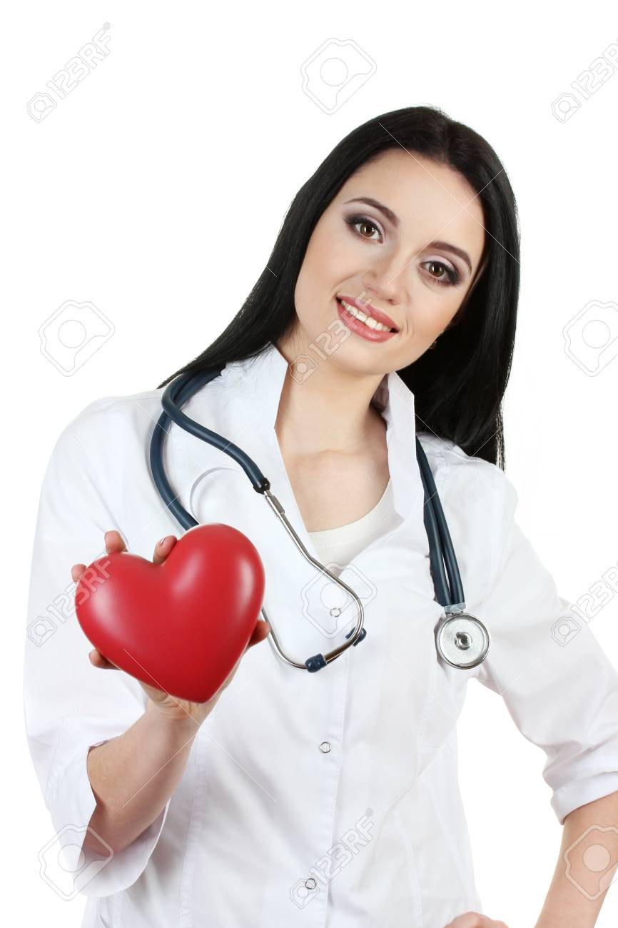 young beautiful doctor with stethoscope holding heart  isolated on white Stock Photo - 14559306