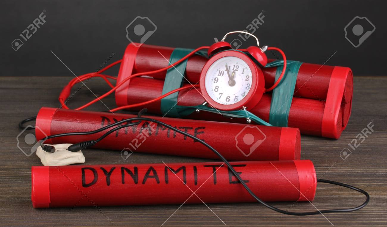 Timebomb made of dynamite on wooden table on grey background Stock Photo - 14135055