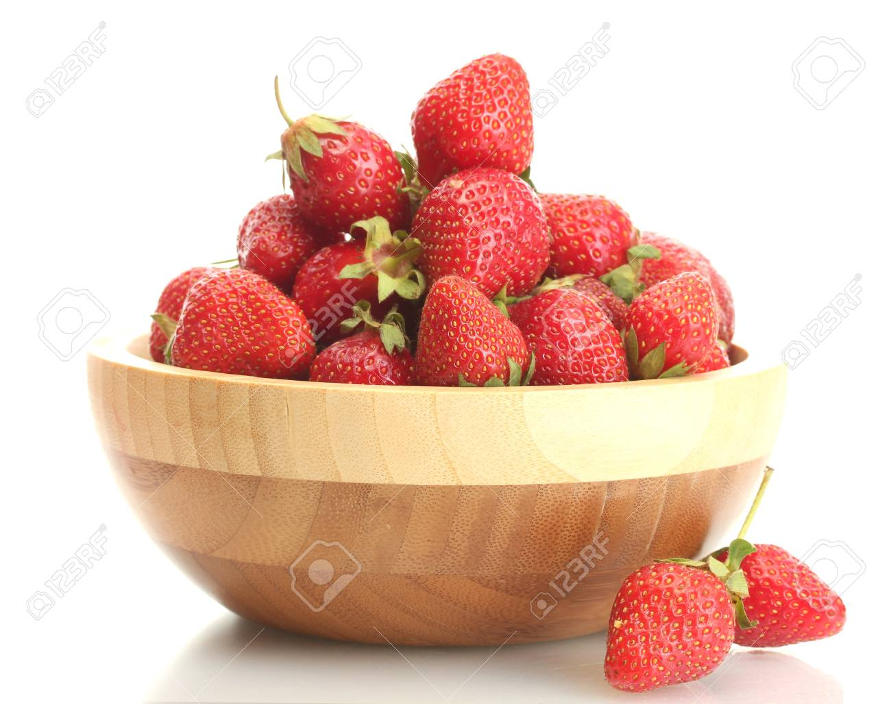 sweet ripe strawberries in wooden bowl isolated on white Stock Photo - 13978555