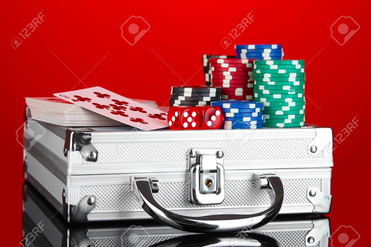Poker set on a metallic case on bright red background Stock Photo - 14158777