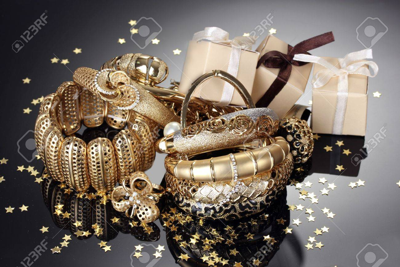Beautiful golden jewelry and gifts on grey background - 14322331