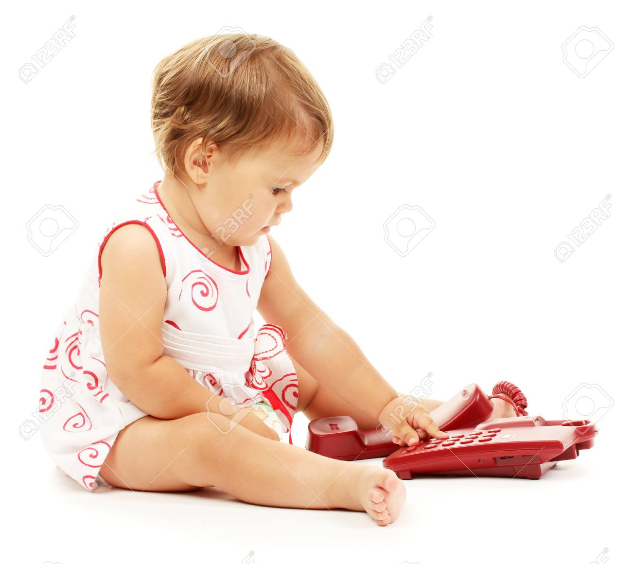 Cute baby with telephone isolated on white Stock Photo - 14843412