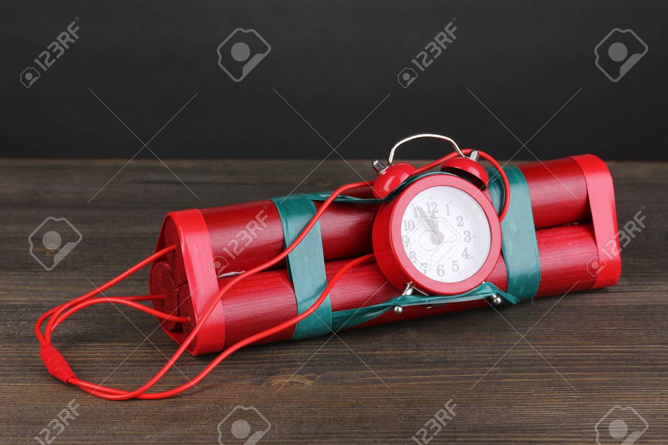 Timebomb made of dynamite on wooden table on grey background Stock Photo - 14558547