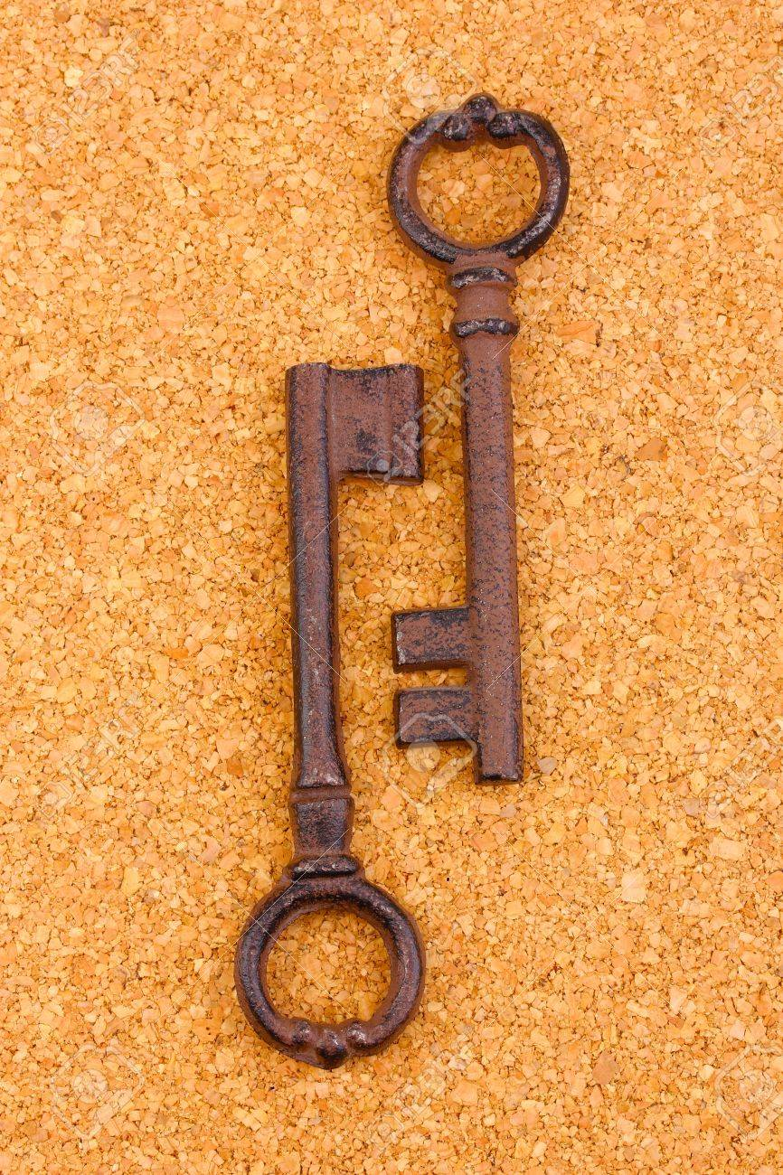 Two antique keys on cork background Stock Photo - 14709842