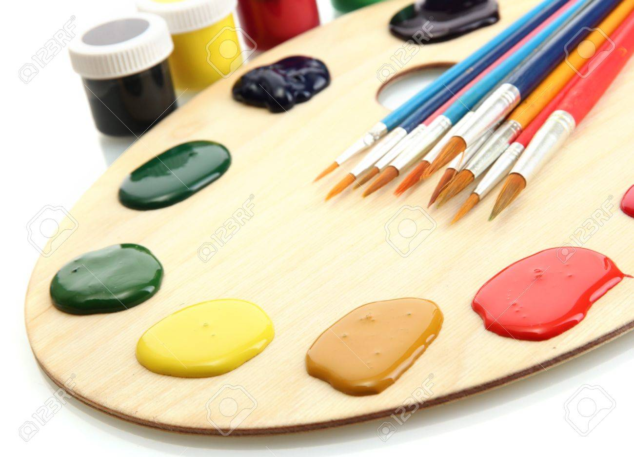 wooden art palette with  paint and brushes isolated on white Stock Photo - 14709113