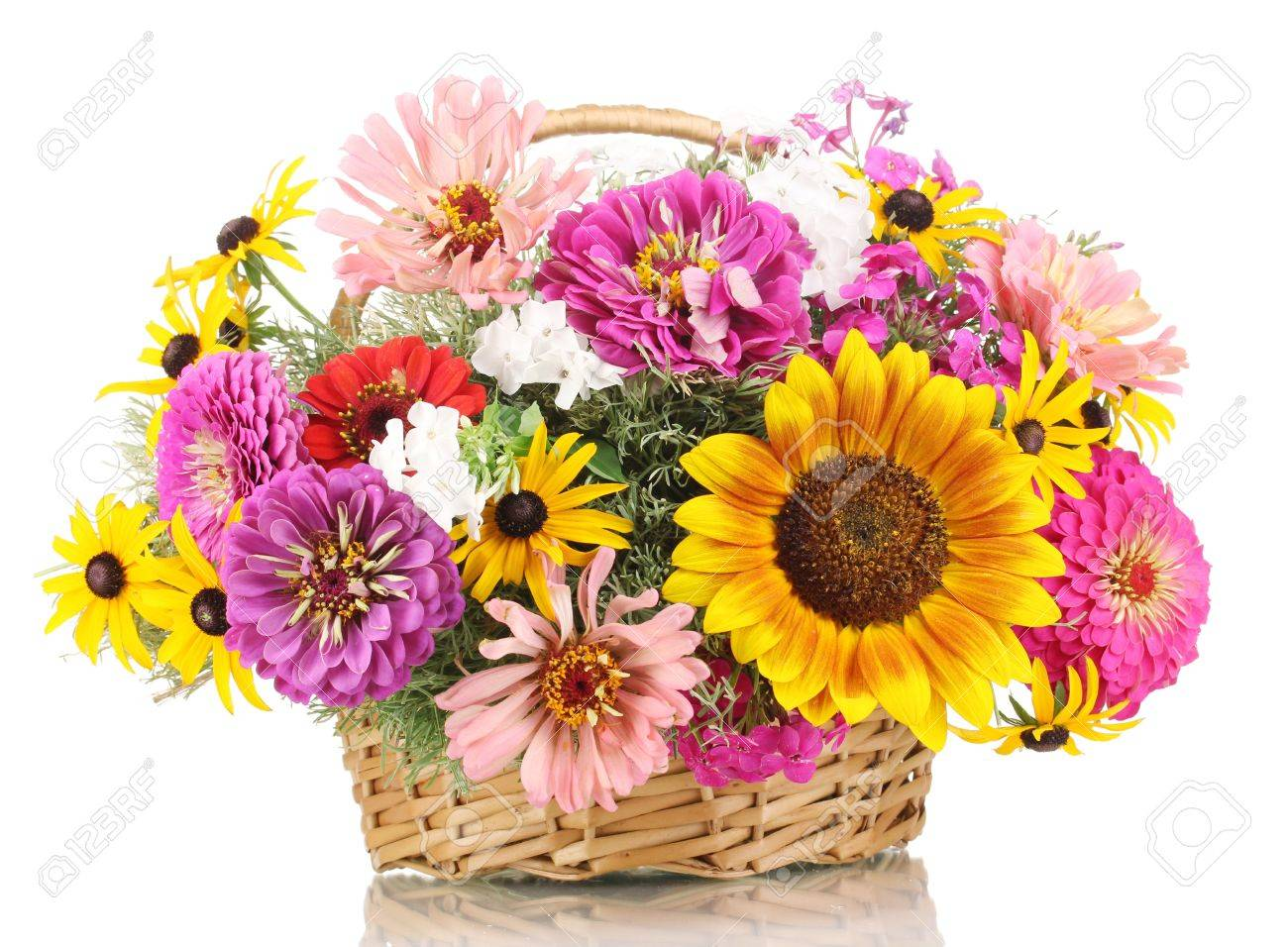 Beautiful bouquet of bright flowers in basket isolated on white Stock Photo - 14709433