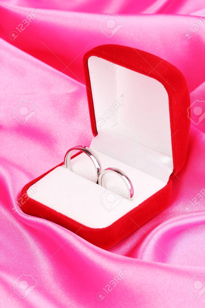 Wedding Rings In Red Box On Pink Cloth Background Stock Photo ...