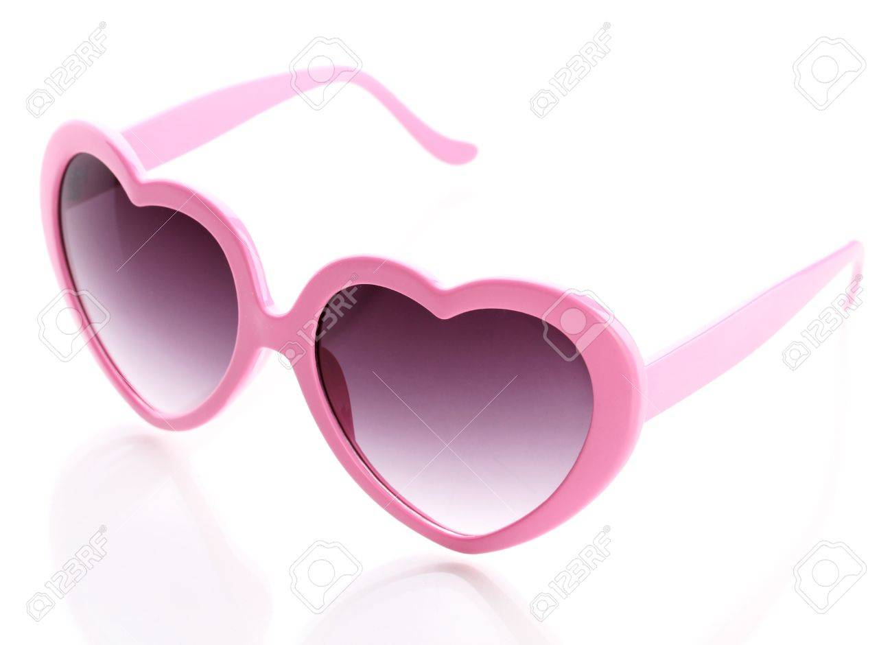 50ea13af4c Pink heart-shaped sunglasses isolated on white Stock Photo - 14956101