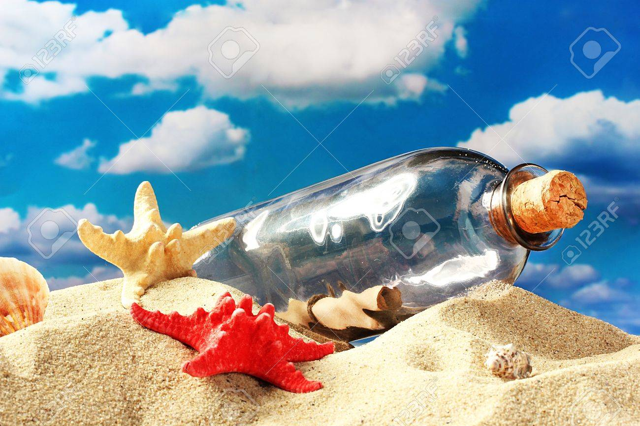 Glass bottle with note inside on sand, on blue sky background Stock Photo - 15096781