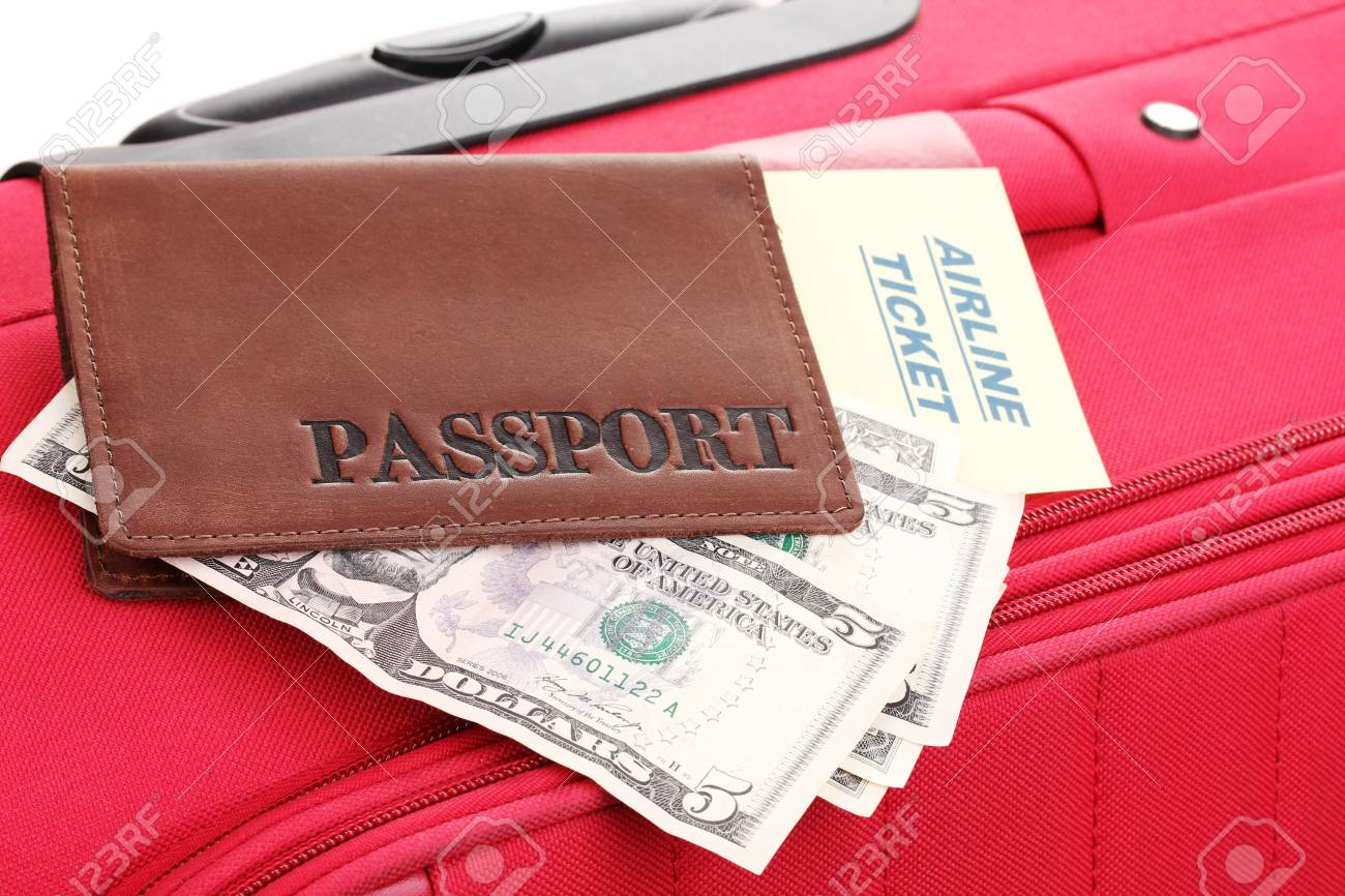 Passport and ticket on suitecase close-up Stock Photo - 15153623