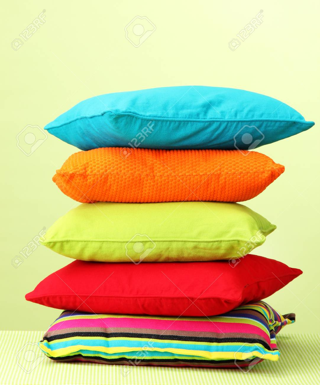 Colorful pillows on yellow background Stock Photo - 15151619