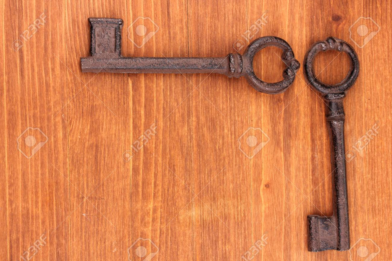 Two antique keys on wooden background Stock Photo - 15506010