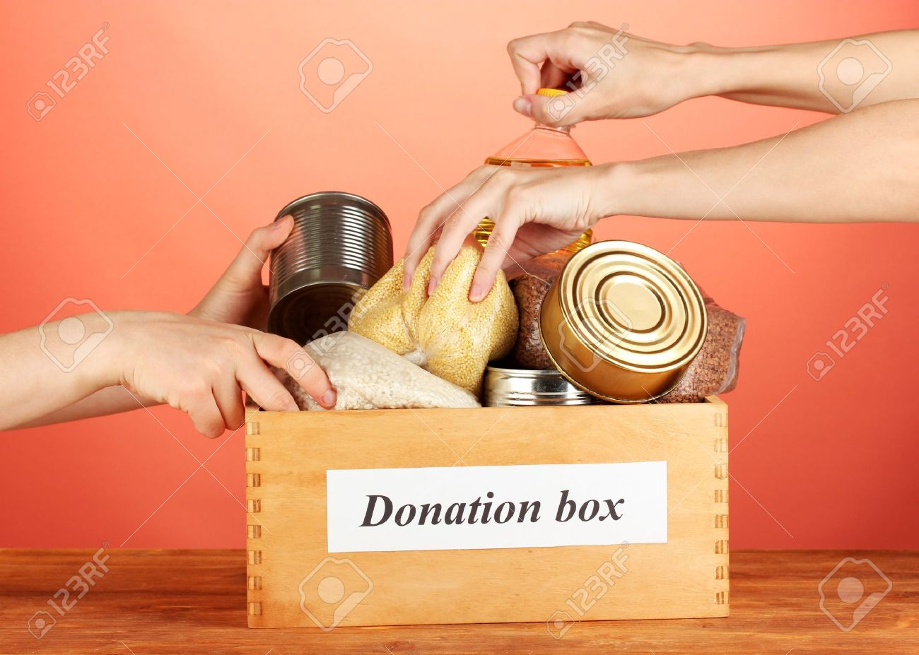 Donation box with food on red background close-up Stock Photo - 15385746