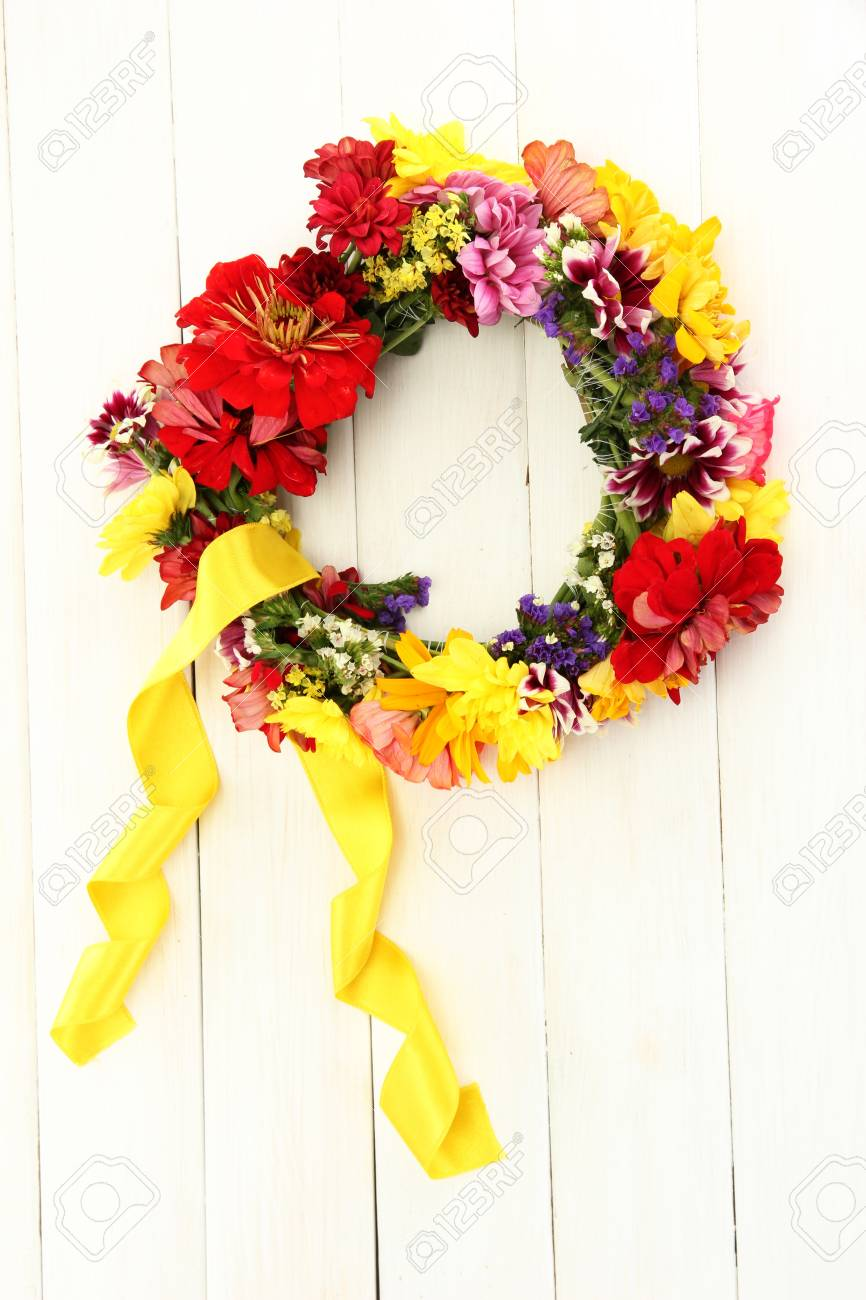 Wreath Of Beautiful Summer Flowers On White Wooden Background Stock