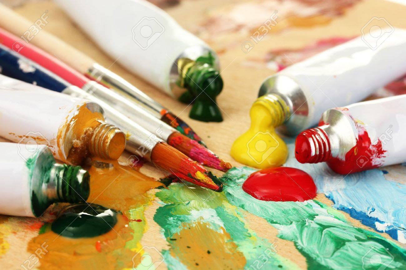 Abstract acrylic paint, paint tubes and brushes on wooden  palette Stock Photo - 15584650